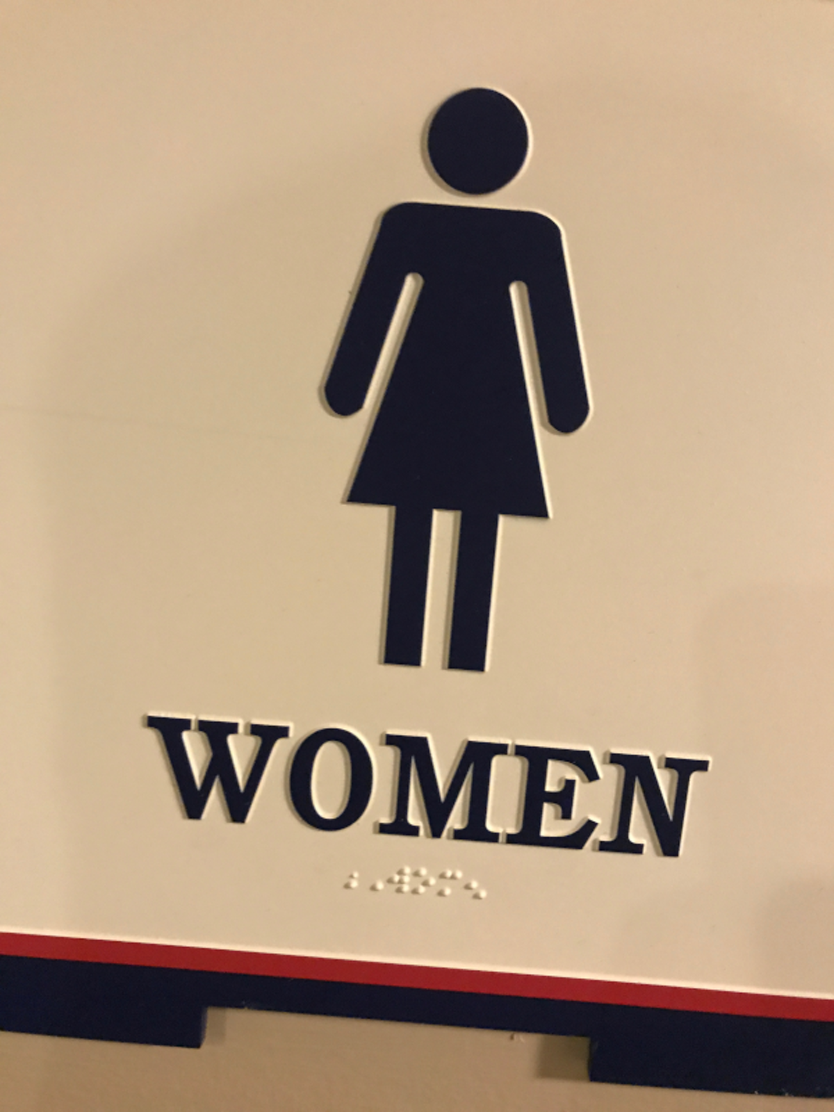 Women's restroom sign with Women in braille