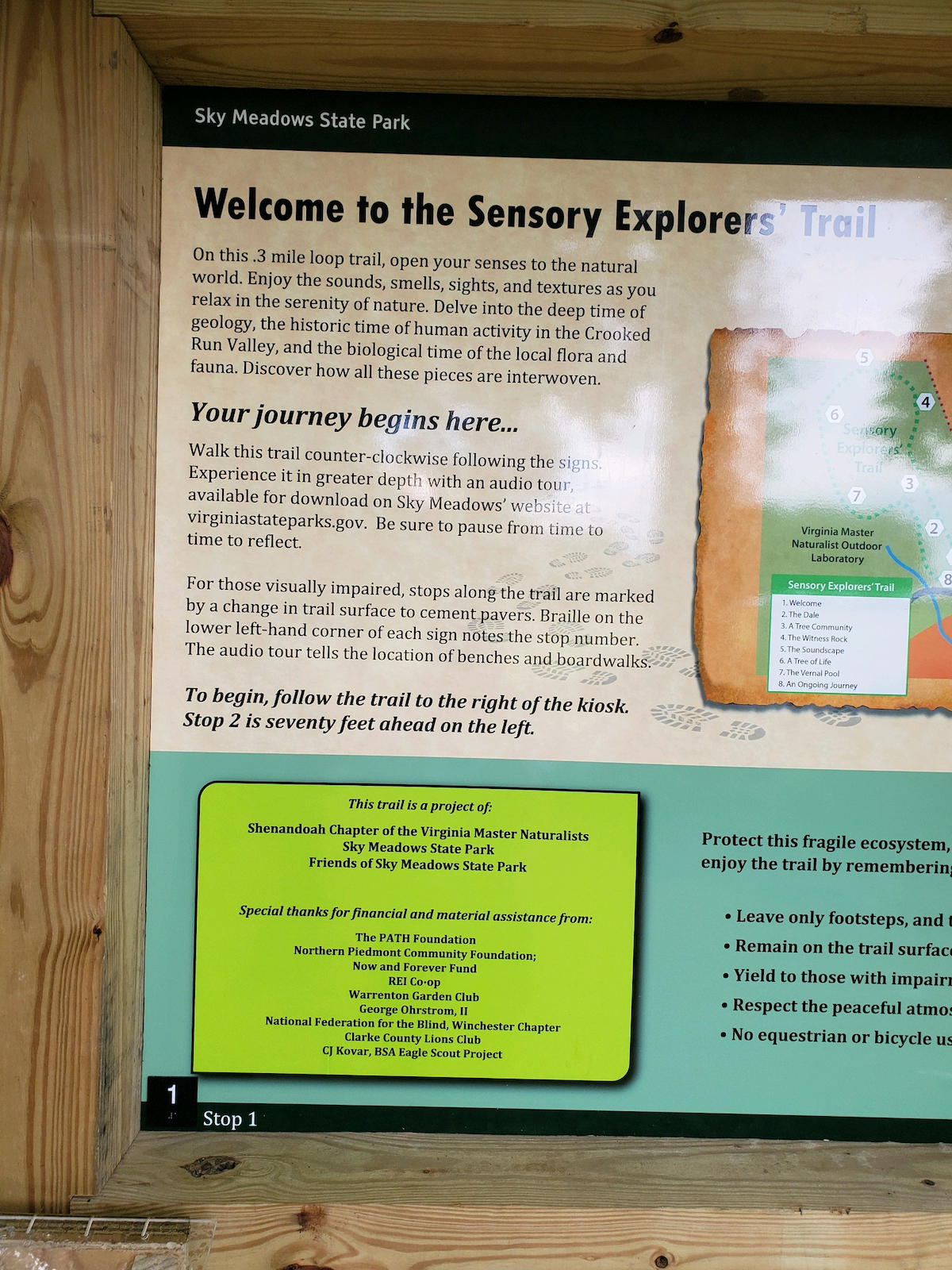 Sign stating Welcome to the sensory explorers trail. Enjoy the sounds, sights, and textures as you relax in the serenity of nature.