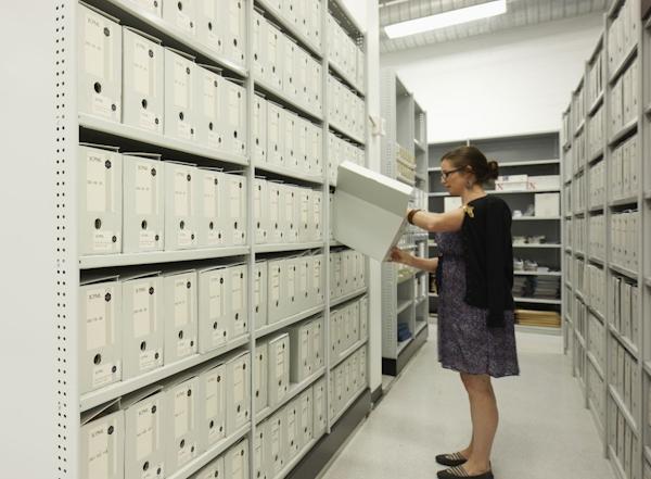 Staff member looking through JCPML archives